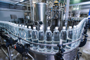 a line of water bottles in production
